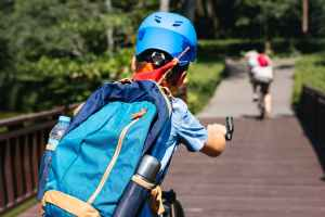 person riding bicycle wearing backpack